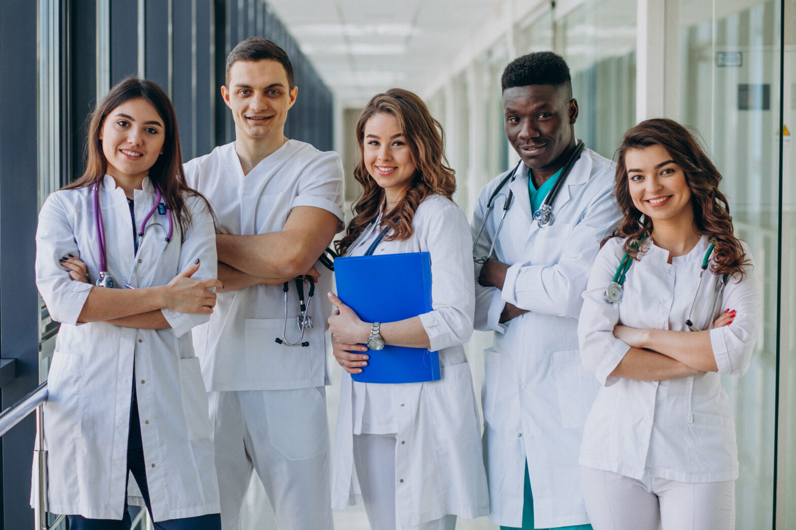 team-of-young-specialist-doctors-standing-in-the-corridor-of-the-hospital